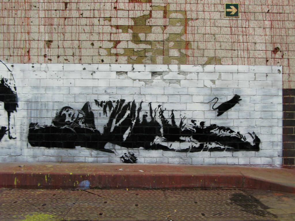 描繪無家可歸流浪漢的街頭作品一隅。圖/取自flickr。